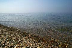 Shore of the lake Baikal. Pure water of lake Baikal stock image