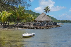 Shore of lake with marae Huahine French Polynesia Stock Images