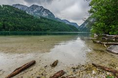 shore by the lake with mountains stock images