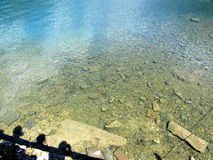 The shore of Lake Ritsa. Abkhazia. Clean water of a protected lake Ritsa stock photos