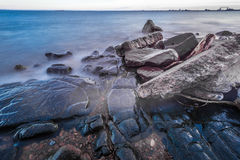 Shore of Lake Superior. Rocky shore of Lake Superior during dusk time Royalty Free Stock Photos