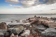 Shore of Lake Superior. Rocky shore of Lake Superior during dusk time Stock Photo