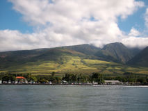 Shore Landscape. View of a harbor town at the bottom of a hill stock photo