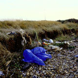 Shore line rubbish. Polymer plastic rubbish thrown up on the shore line by the sea Stock Image