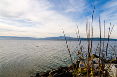 Shore of Lipno Lake  in autumn. Shore of Lipno Lake with rocks in foreground. Taken in autumn in Czech Republic. Nice view of lake in windy weather Royalty Free Stock Image