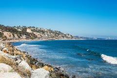 Shore in Malibu. Sunny day at the pacific ocean. Shore in Malibu. Stones along the rugged coast pacific ocean near Malibu, CA Stock Photo