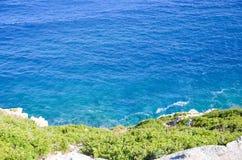 Shore meets the blue sea Stock Photos