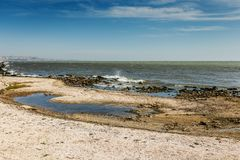Free Shore Of The Caspian Sea With Pebbles And Waves. Stock Photography - 113555872