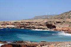 Shore and power generating windmills near Plaka, C Royalty Free Stock Photography