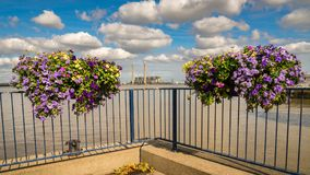 Gravesend, England, UK. The shore of the River Thames in Gravesend, Kent, England, UK - with flower boxes and Tilbury Power Station stock photography