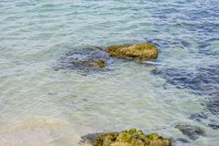 Shore, Rocks by the sea with waves of the Mediterranean sea next. To the Cabo de Formentor in the Balearic Islands, Spain. Scenes of Spanish tourism Royalty Free Stock Image