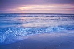 Shore Ruffles. Beach waves at sunset, Wassenaarse Slag Royalty Free Stock Photo
