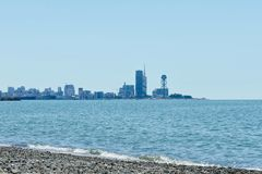 Shore of the sea and the city of Batumi in the distance. sunny day.  Stock Image