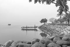 Shore of the Sea of Galilee, in Ein Gev. View of the eastern shore of the Sea of Galilee, in Ein Gev, on a foggy day, Northern Israel royalty free stock photo