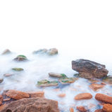 Shore of the sea, rocks and flowing water - white background Stock Photo