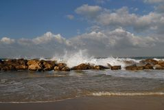 The shore of the sea, the waves break down on the coastal stones, sand. Shore of the sea, the waves break down on the coastal stones, sand Stock Images