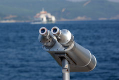 Shore and ships viewed by binocular stock photos