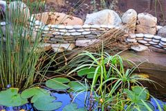 A small pond , whose banks are decorated with sculptural images stock photography