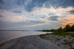 On the shore. Sunset on the shore of Volga Royalty Free Stock Photography