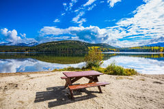 On the shore  -  table and benches for picnic Royalty Free Stock Image