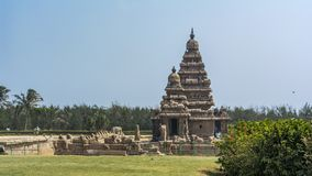 Shore Temple at Mahabalipuram with lawn in front royalty free stock photography
