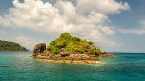 Shore of an uninhabited tropical island in the ocean. Uninhabited tropical island in the ocean, Thailand Stock Image