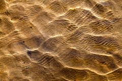Shore waters over yellow sand Royalty Free Stock Photos