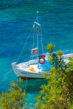 Shored boat in sea Royalty Free Stock Image