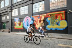 Free Shoreditch District In London With Cyclists On The Streets With Graffiti , As Cycling Boom During Covid  Corona Virus Crisis 2020 Royalty Free Stock Images - 184117839