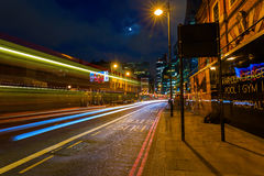 Shoreditch High Street in London, UK, at night Stock Photos