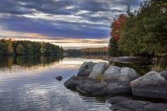 Shoreline of an Autumn Lake at Sunset - Ontario, Canada. Rocky Shoreline of an Autumn Lake at Sunset - Ontario, Canada Stock Photo