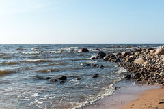 Shoreline of Baltic sea beach with rocks and sand dunes Stock Photos