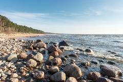 Shoreline of Baltic sea beach with rocks and sand dunes Royalty Free Stock Photos
