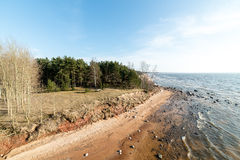 Shoreline of Baltic sea beach with rocks and sand dunes Stock Image