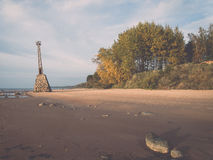 Shoreline of Baltic sea beach with rocks and sand dunes. Vintage Stock Images