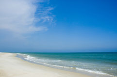 Shoreline and blue sky. The shoreline of the Gulf of Mexico on a sunny day royalty free stock images