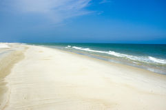 Shoreline and blue sky. Blue sky and a sandy beach along the Gulf of Mexico royalty free stock photos