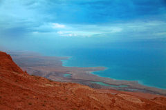 The shoreline of Dead Sea at dawn Royalty Free Stock Photography