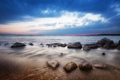Shoreline and Dramatic Clouds Over Lake Chiemsee Stock Image