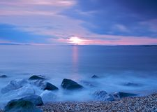 Shoreline at dusk. A view of a rocky shoreline along the Hurst Split, Hampshire, UK, at dusk Royalty Free Stock Photos