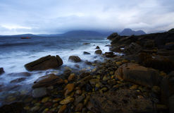Shoreline at dusk, isle of skye. Shoreline at twilight, by a rainy and windy day at Elgol port in scotland, isle of skye Royalty Free Stock Photos