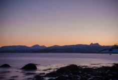 Shoreline of Fjords, taken at Bakkejord, near Tromso Norway March 2019. Shoreline of Fjords with mountains beyond , taken at Bakkejord, near Tromso Norway March royalty free stock image