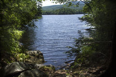 Shoreline and fresh water of Mountain View Lake, New Hampshire. Stock Image