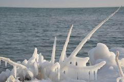 Shoreline ice formation after storm Stock Images