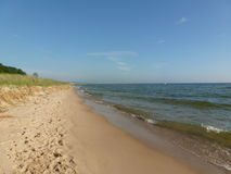 Shoreline. The shoreline of Lake Michigan with gentle waves breaking on the beach Royalty Free Stock Photography