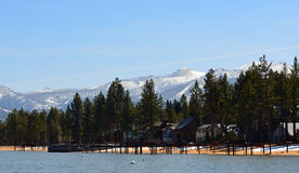 The shoreline of Lake Tahoe, California. The shoreline of Lake Tahoe, California with the majestic, snow-capped mountains surrounding it, in the backround Stock Image