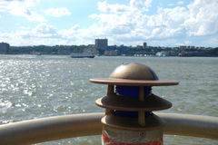 Shoreline. A light on the Manhattan shoreline, bordering the Hudson River Stock Image