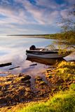 Shoreline Morning. A fishing boat stands ashore on a beautiful morning stock images