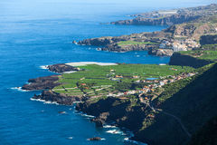 Shoreline of northern side of Tenerife island with blue Atlantic ocean. Aerial view at green plantations. Canary, Spain, Europe Royalty Free Stock Image
