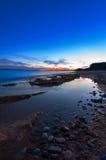 Shoreline på skymningen Fotografering för Bildbyråer
